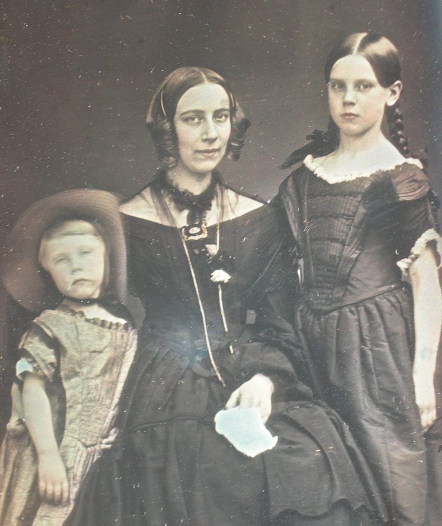http://www.costumecocktail.com/2015/08/07/lovely-young-mother-with-children-1850s/
