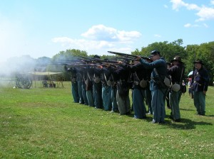 Aug. 2014: Union reenactors in battle stance, Governors Island, N.Y.